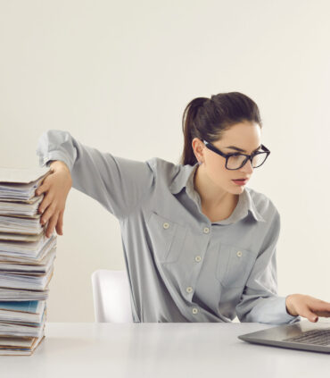 Young,Accountant,Working,On,Laptop,Computer,Sitting,At,Desk,With